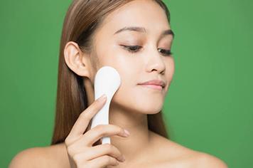 woman using electric facials. skincare concept