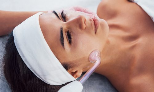 close up view of woman that lying down in spa salon and have face cleaning procedure by using modern device